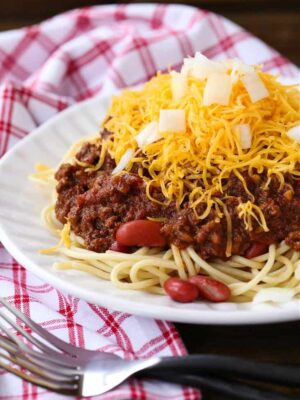 Cincinnati Chili served over spaghetti with beans, cheese and onions
