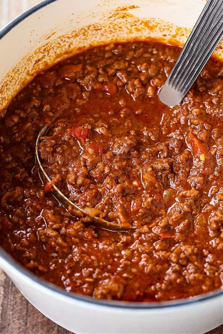 chili recipe in a pot with ladle