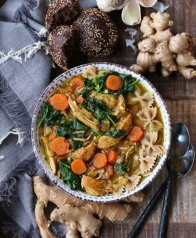Chicken Soup in a bowl with vegetables and whole wheat pasta