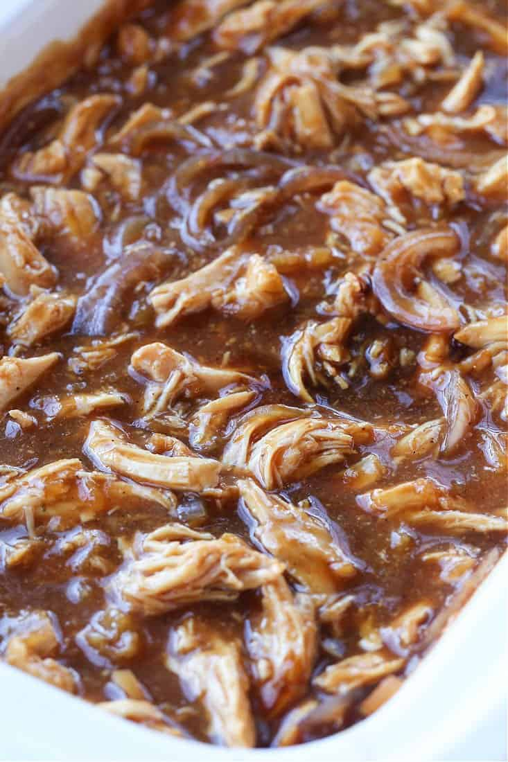 pulled chicken in sauce in a slow cooker