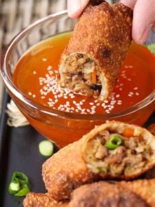 Pork Egg Roll recipe dipping into duck sauce