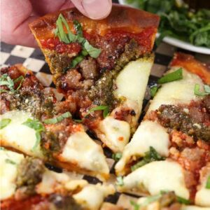 Sausage pizza with basil pesto and fresh mozzarella cheese