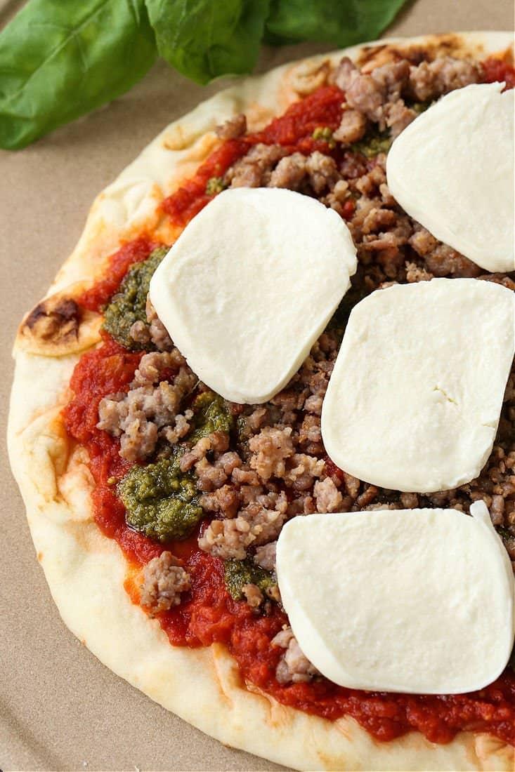 Fresh mozzarella and Italian sausage on a homemade pizza