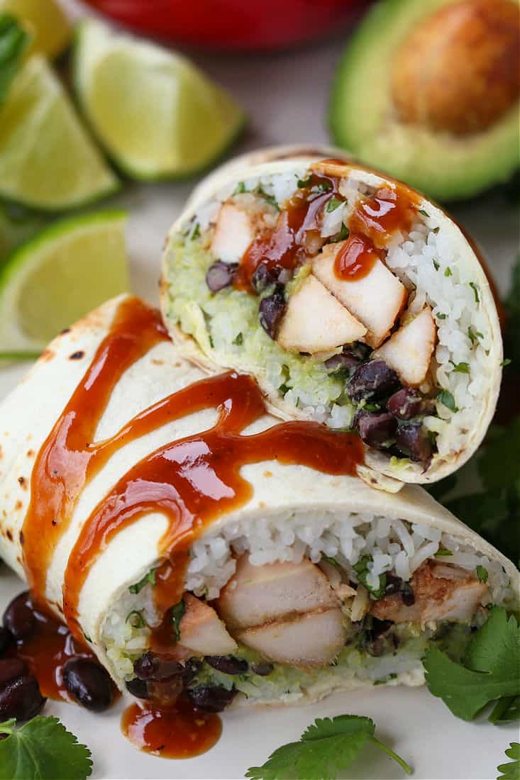 Teriyaki Chicken Burritos with sauce drizzled over the tops
