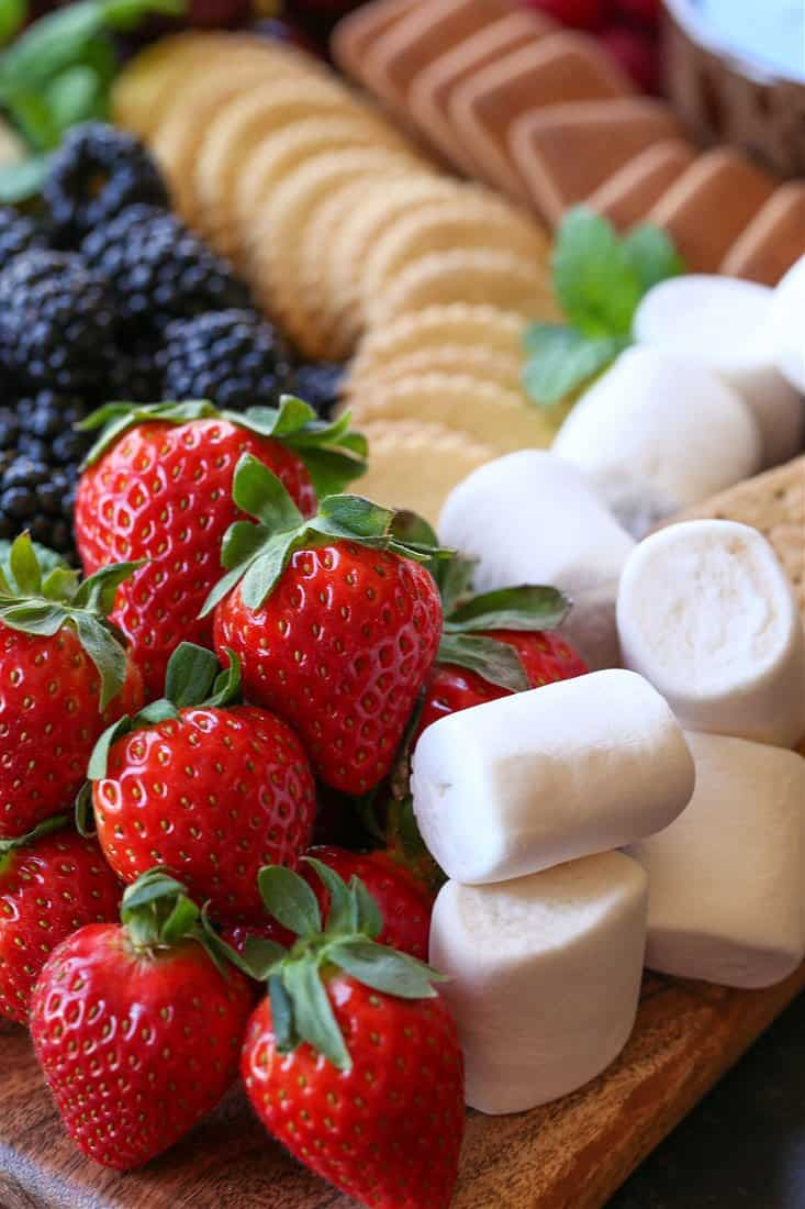 Strawberries, marshmallows and cookies for dipping into chocolate fondue