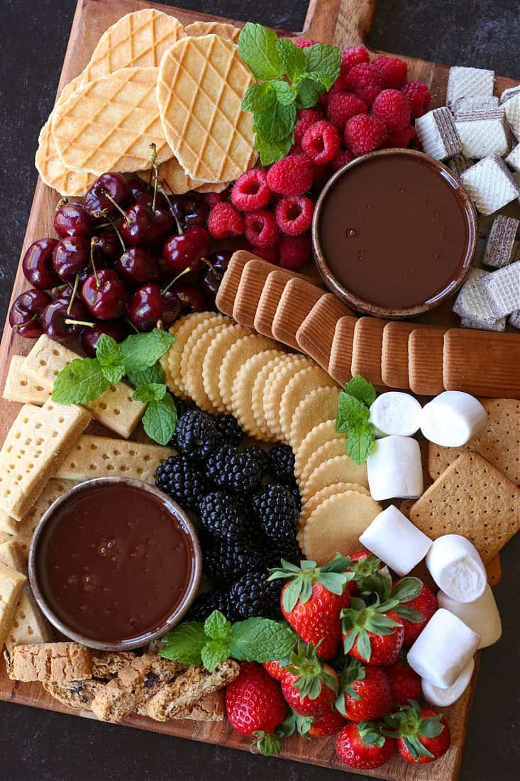 Dessert board with chocolate fondue for dipping