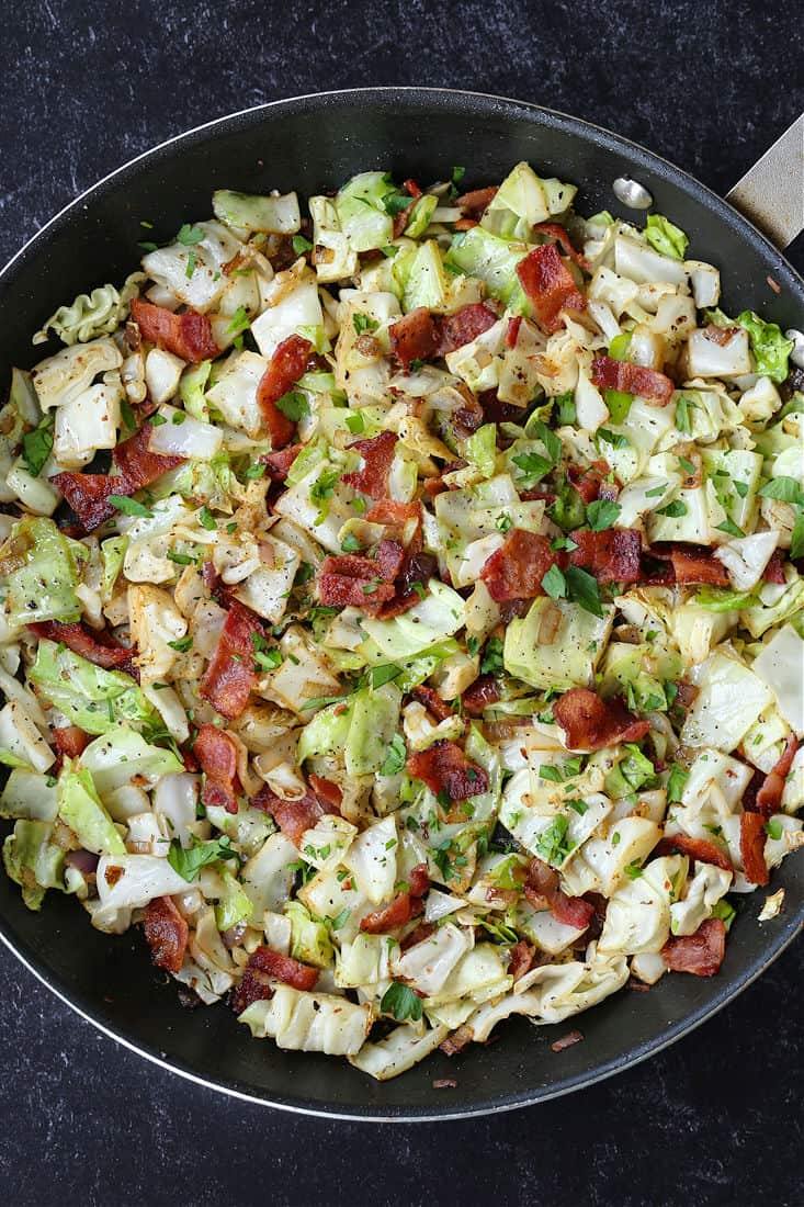 Fried cabbage with bacon in a skillet
