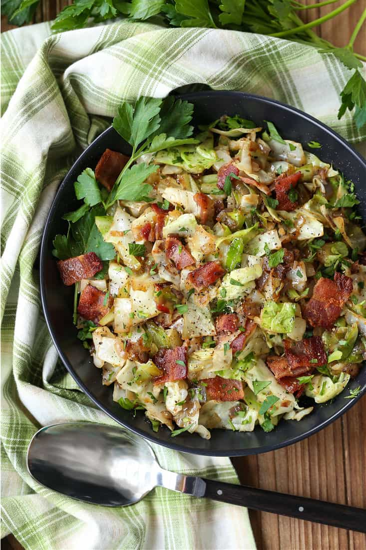 Fried Cabbage with bacon in a black bowl