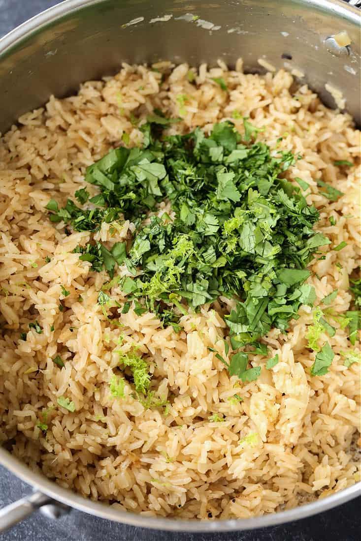 Rice recipe with fresh cilantro in a pot