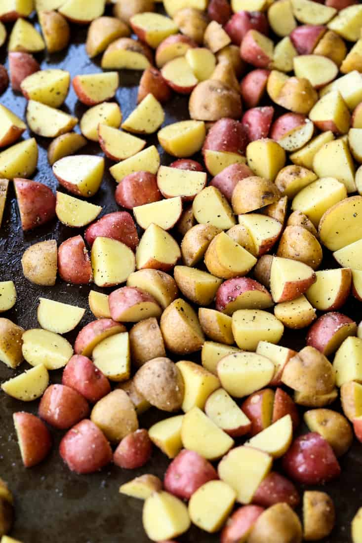 Diced potatoes on a baking sheet for roasted potato recipe