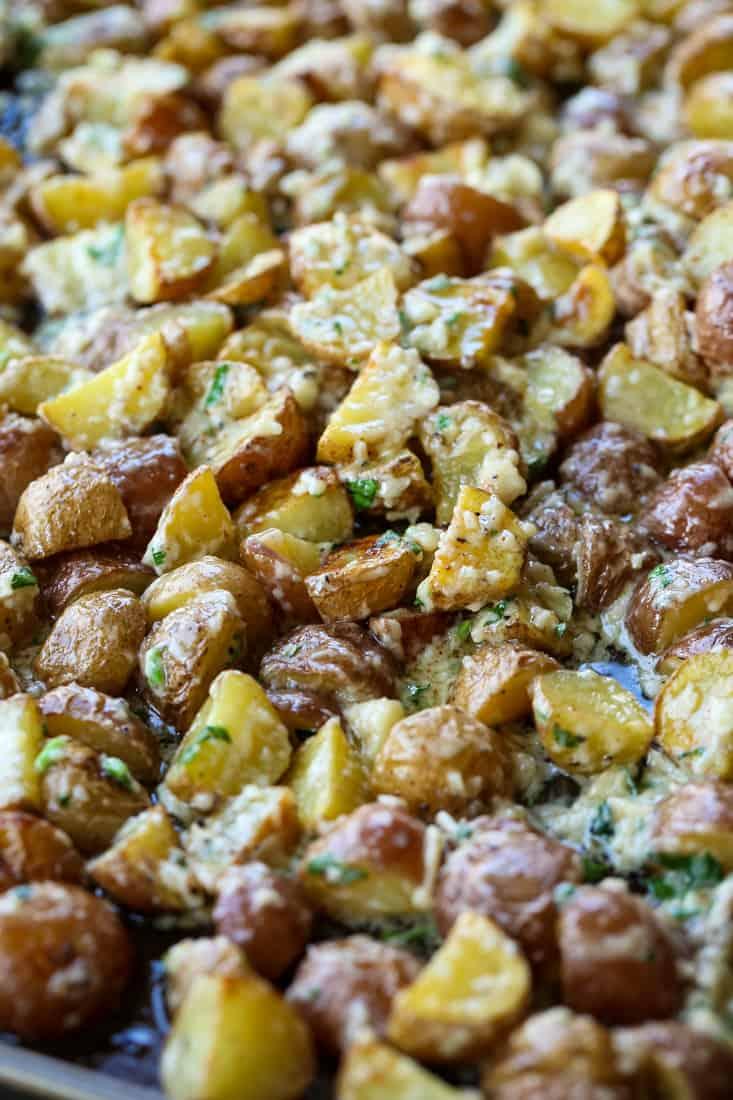 Garlic Parmesan Potatoes tossed in sauce
