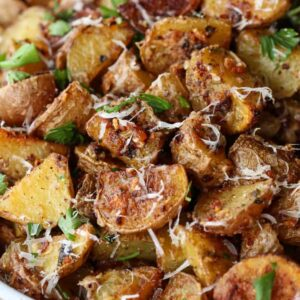 Garlic parmesan roasted potatoes in a bowl with parmesan cheese