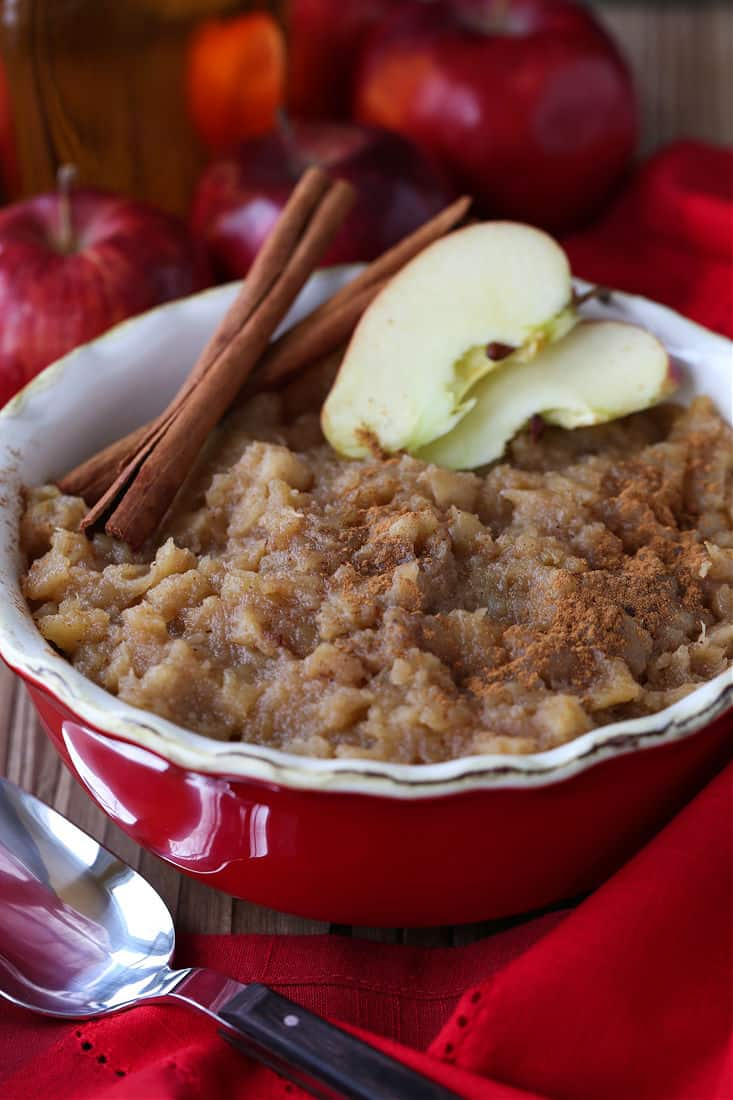 Homemade Bourbon applesauce in a red bowl with spoon