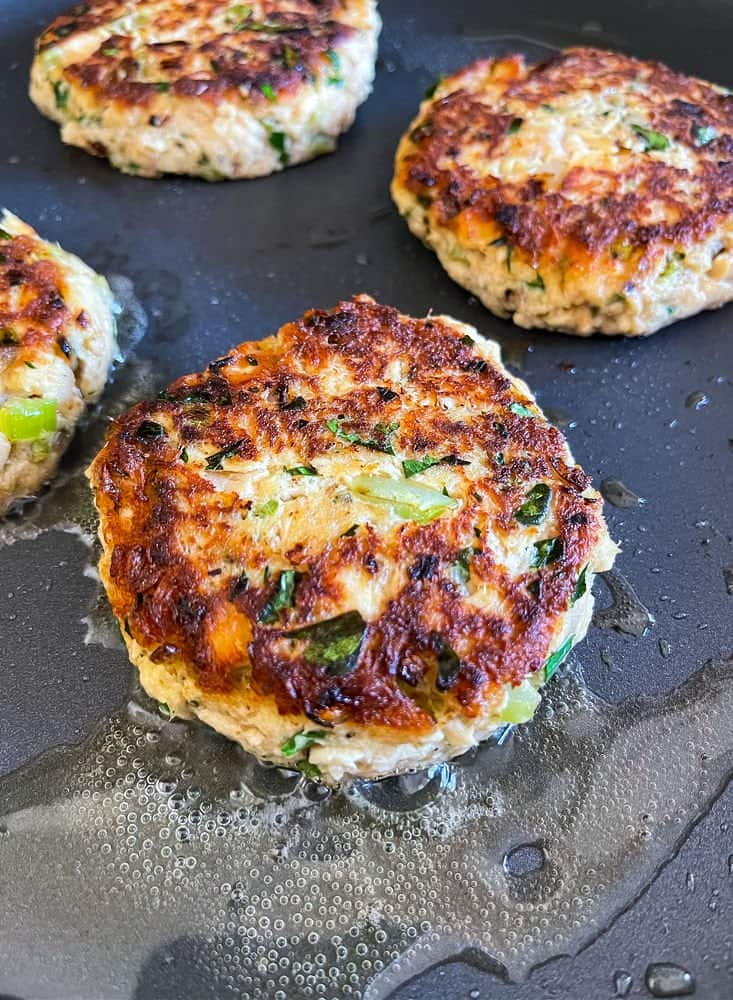 cooked tuna cakes in a skillet