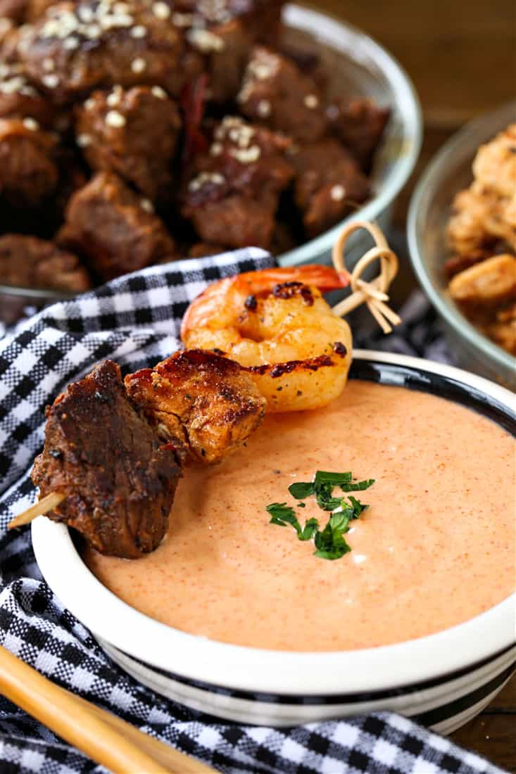 Yum Yum Sauce in a bowl with steak, shrimp and chicken