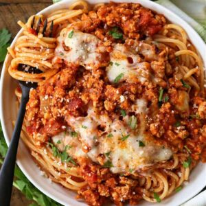 Ground chicken recipe served over spaghetti
