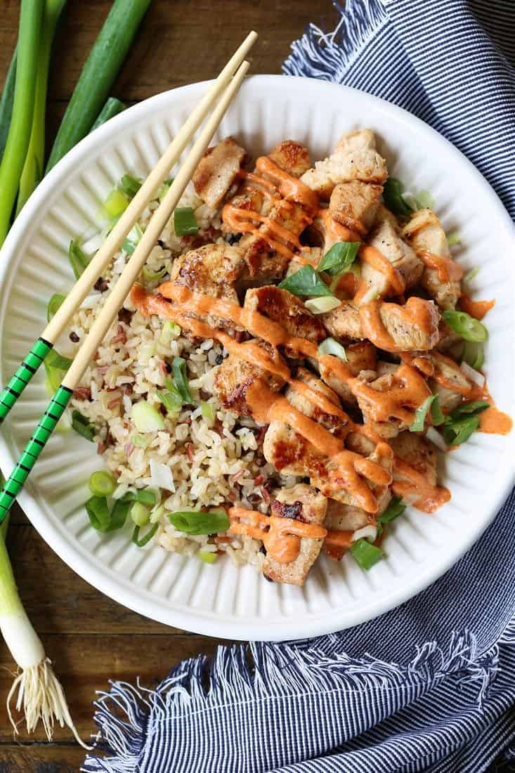 Hibachi Chicken in a bowl with rice and chop sticks