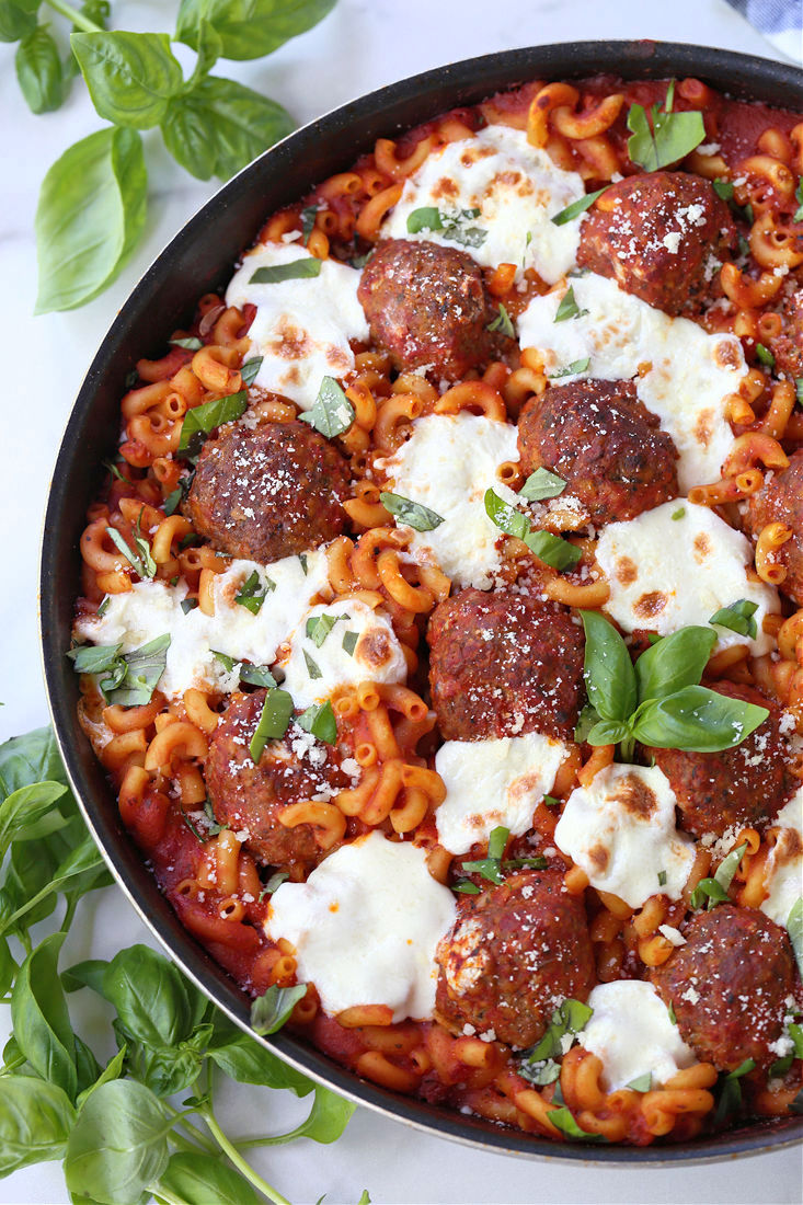 Meatballs and mozzarella cheese with baked pasta