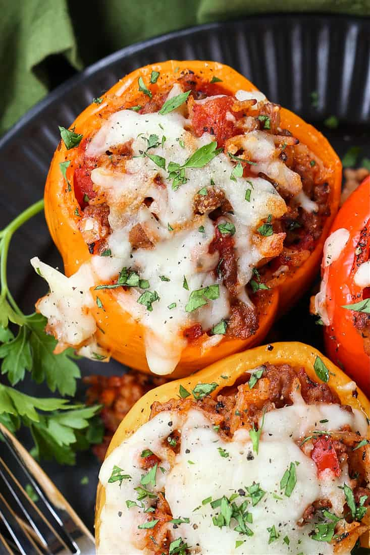 bell peppers stuffed with ground beef and rice and topped with mozzarella cheese