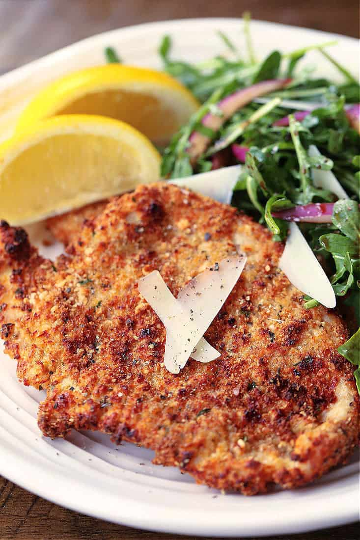 Turkey or Chicken cutlets with lemon wedges and salad