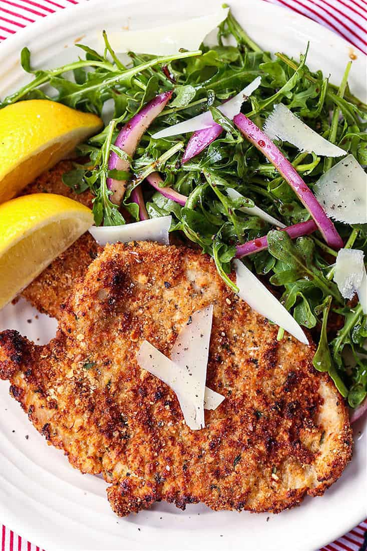 Breaded turkey cutlets on a plate with salad