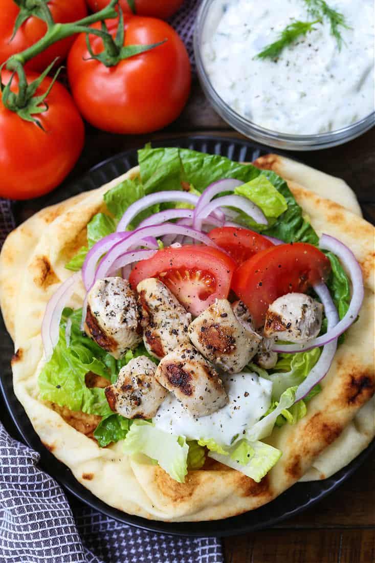 Chicken Souvlaki on a pita with garnish