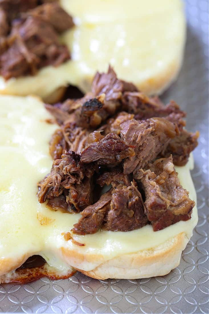 Shredded beef on sub rolls with melted cheese