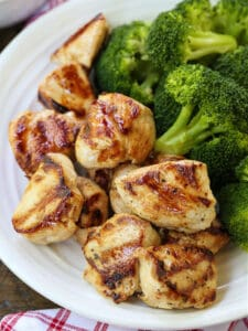 grilled chicken nuggets on a plate with broccoli