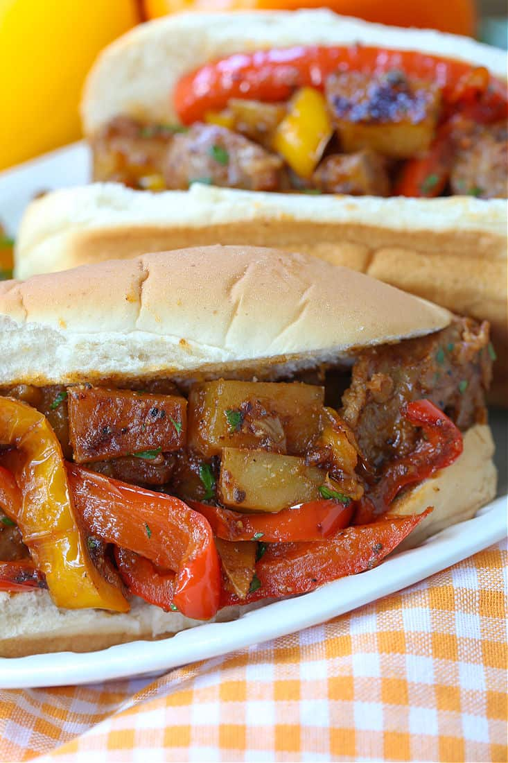 Italian sausage and potatoes served on a sub roll