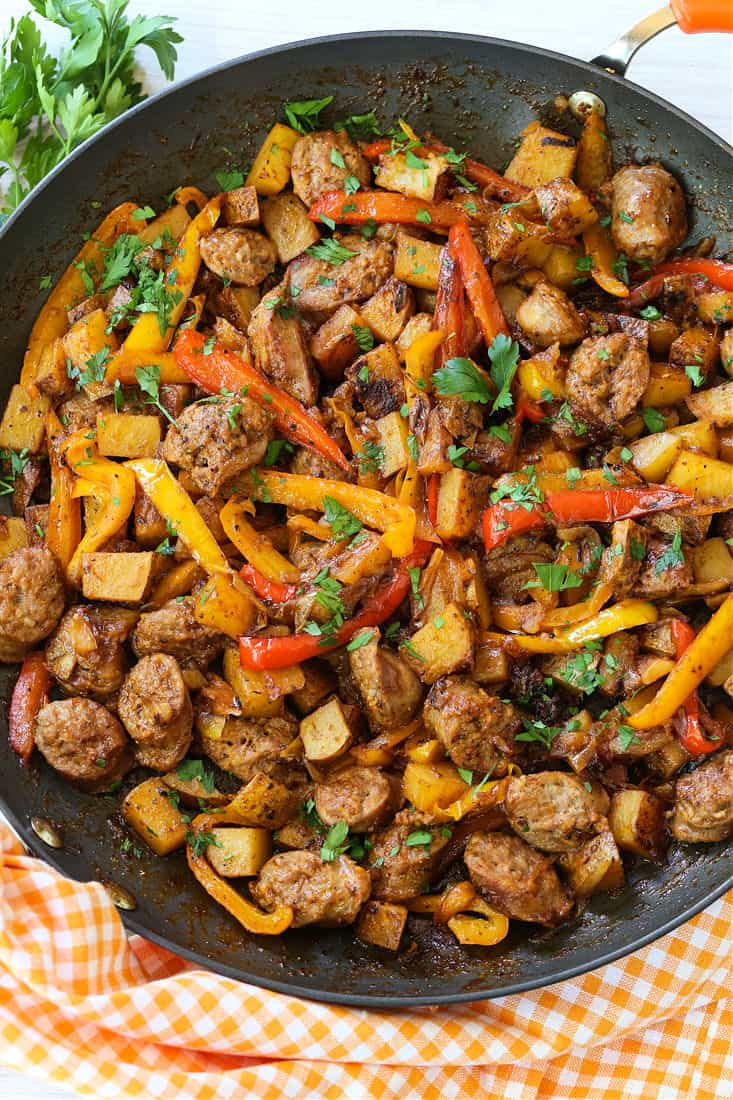 Italian sausage, peppers and potatoes in a skillet