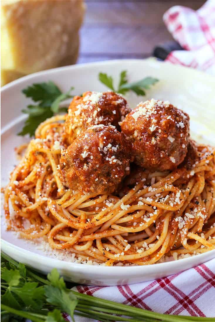 meatballs and sauce recipe served on top of spaghetti