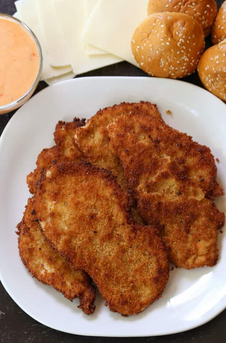 fried chicken cutlets with slider buns, mozzarella cheese and bang bang sauce