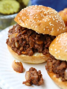 Sloppy Joe sliders on a plate with tater tots