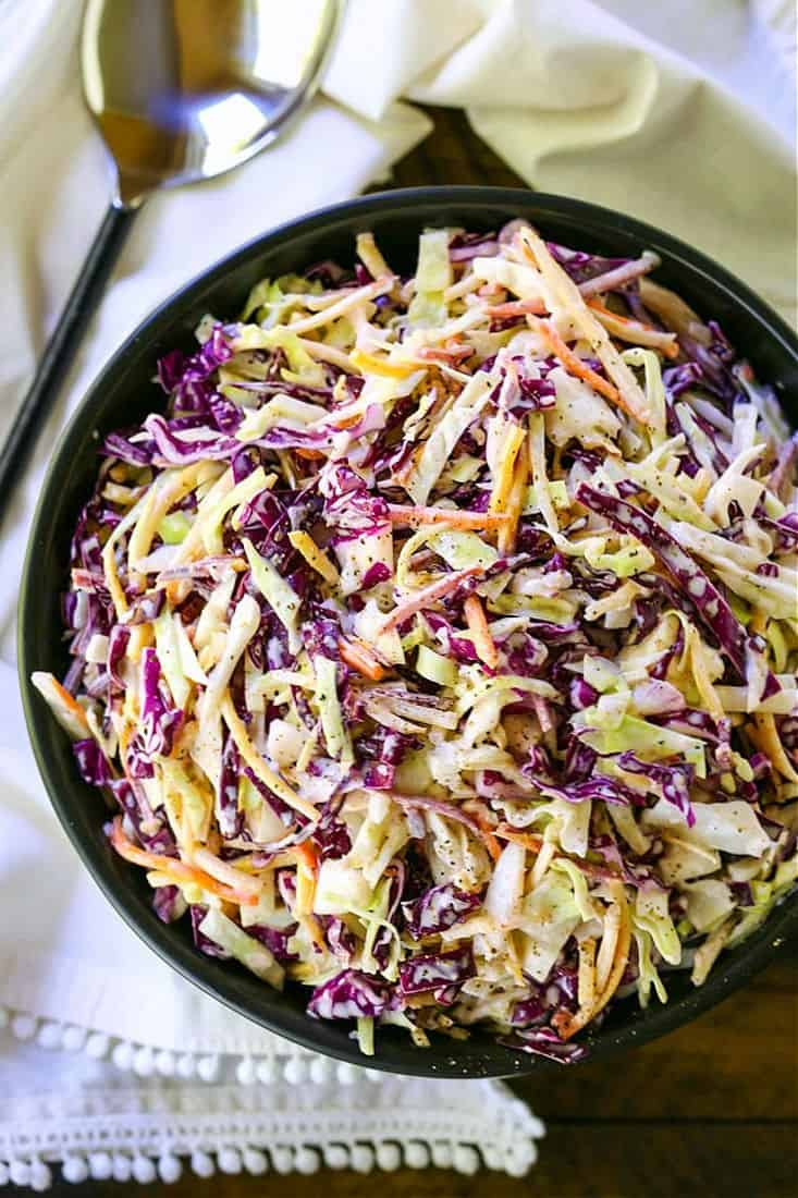 coleslaw in a bowl with spoon
