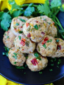 Chicken Meatballs with peppers on a plate with cilantro
