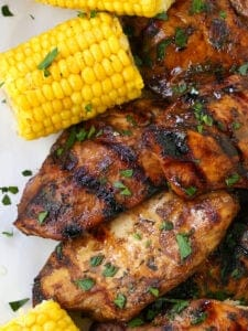 Chicken in the Grill served with corn on the cob