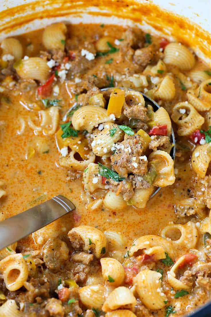 Creamy Sausage and Peppers Soup in a pot with ladle