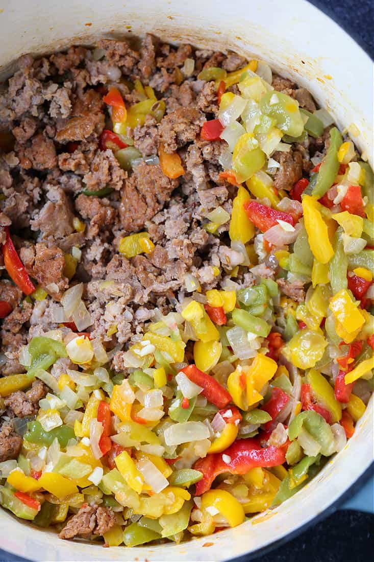 Italian sausage, peppers and onions in a pot for soup recipe