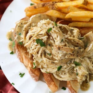 Crock Pot Chicken and Gravy served over toast with french fries
