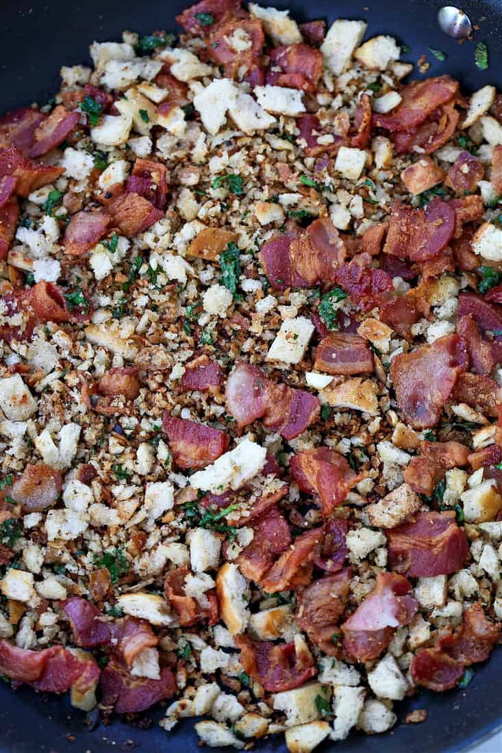 bacon and fresh bread crumbs toasting in a skillet