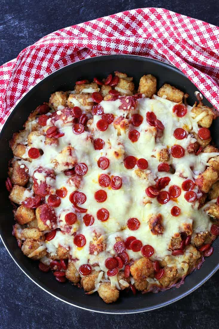 Pizza Totochos in a skillet with checkered napkin