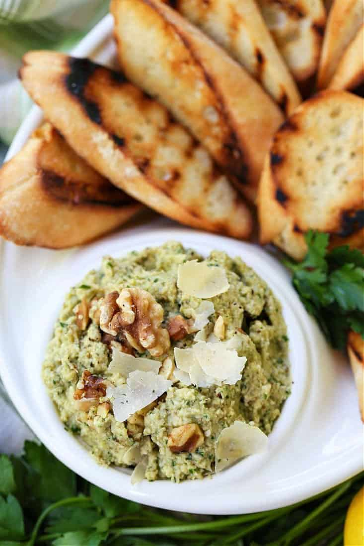 Walnut pesto with artichokes and parmesan cheese in a serving dish