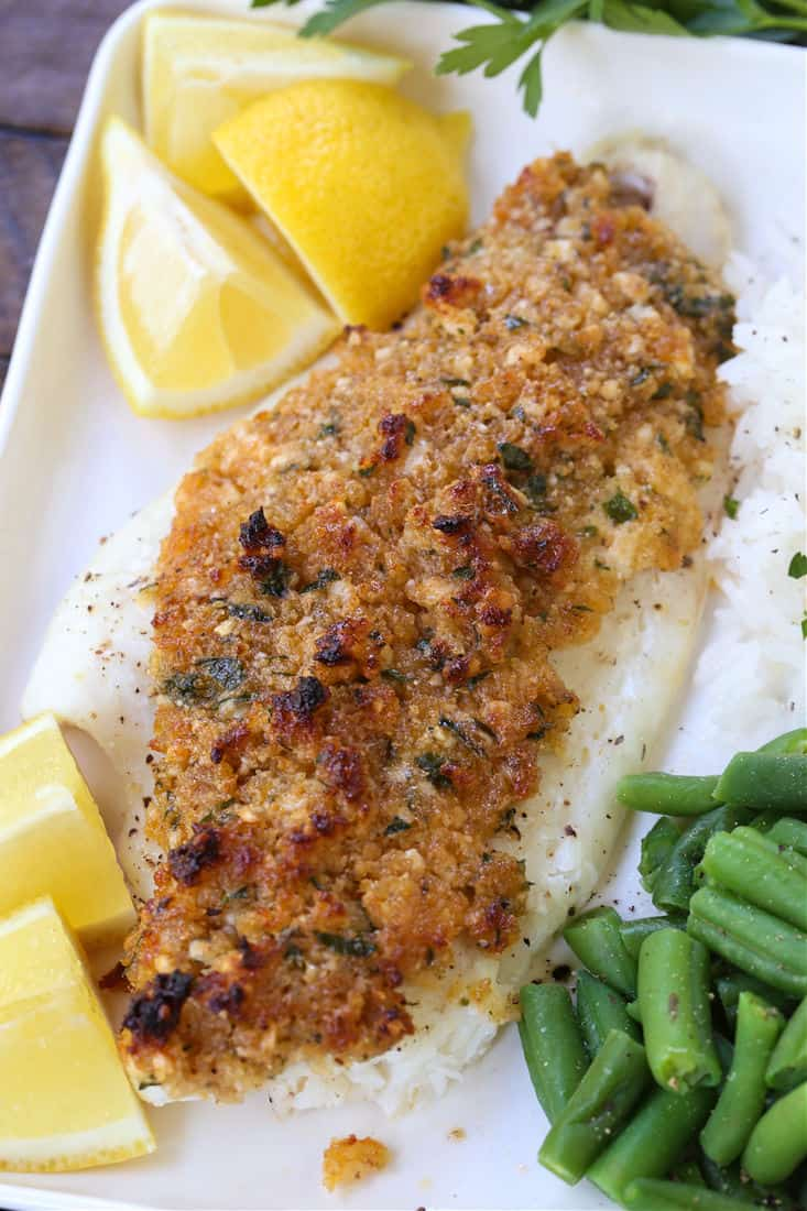 Parmesan Crusted Haddock on a plate with green beans and rice