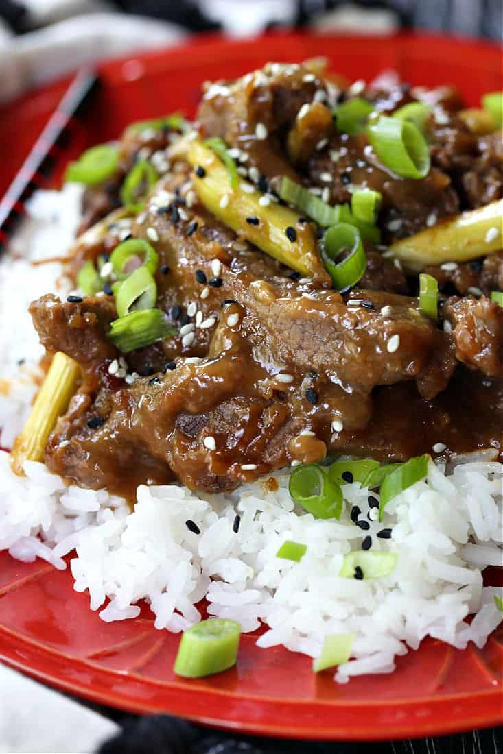 Crock Pot Mongolian Beef with scallions served over rice