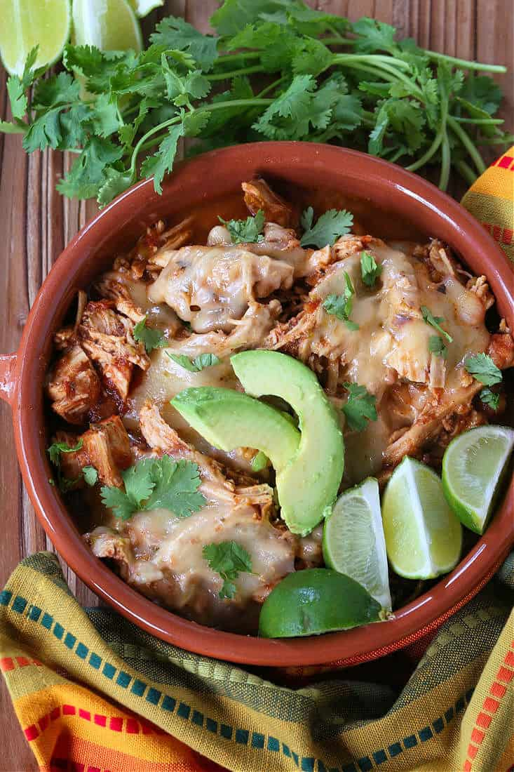 Slow Cooker Taco Chicken in a bowl with limes