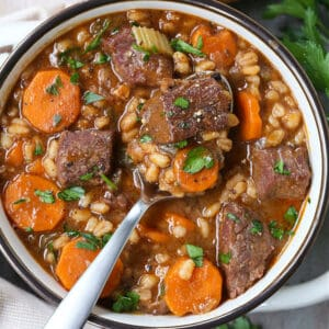 Beef Barely soup in a bowl with a spoon