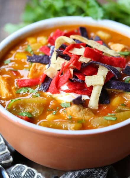 Chicken Fajita Soup in a bowl with napkin and spoons