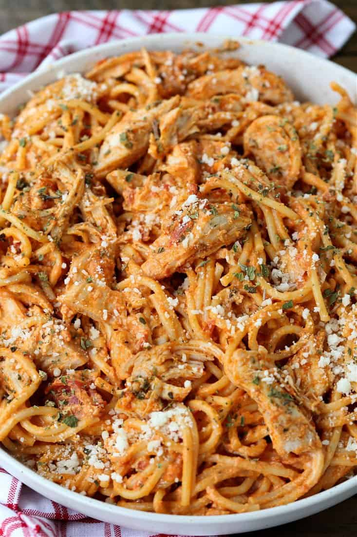 Easy Chicken Spaghetti recipe in a bowl topped with parmesan cheese
