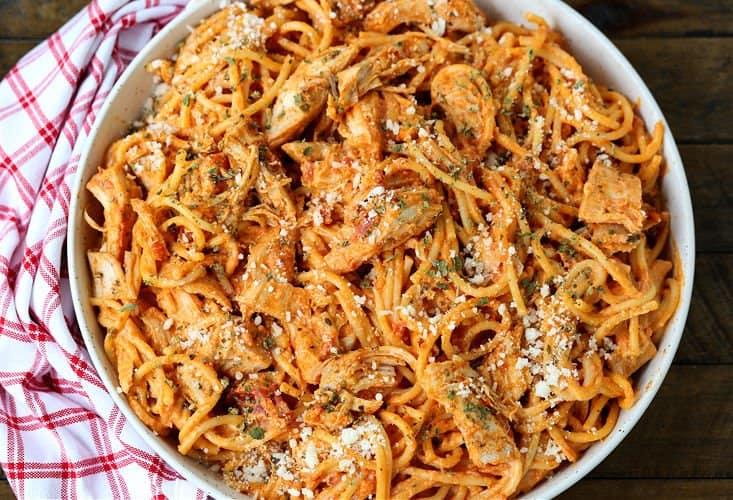 Chicken Spaghetti in a bowl on a board