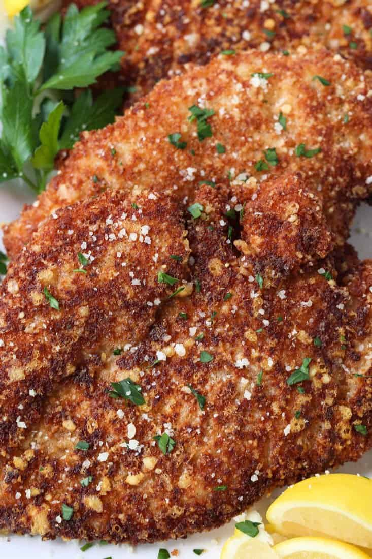 Breaded chicken cutlets with grated parmesan cheese